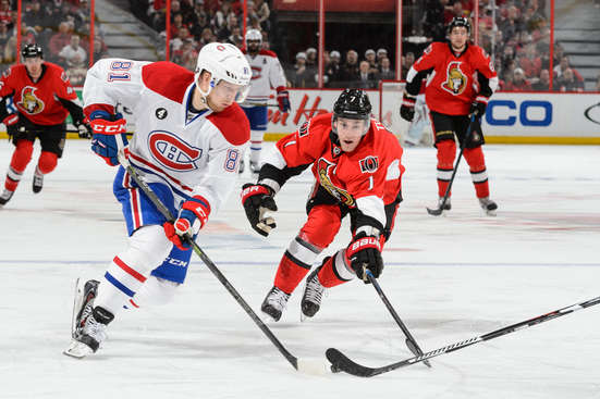 OTTAWA, ON - APRIL 26: Lars Eller #81 of the Montreal Canadiens tries to move the puck past Kyle Turris #7 of the Ottawa Senators in Game Six of the Eastern Conference Quarterfinals during the 2015 NHL Stanley Cup Playoffs at Canadian Tire Centre on April 26, 2015 in Ottawa, Ontario, Canada. (Photo by Minas Panagiotakis/Getty Images)
