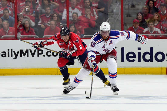 WASHINGTON, DC - MAY 06:  Marc Staal #18 of the New York Rangers moves the puck up ice against Alex Ovechkin #8 of the Washington Capitals during the first period in Game Four of the Eastern Conference Semifinals during the 2015 NHL Stanley Cup Playoffs at Verizon Center on May 6, 2015 in Washington, DC.  (Photo by Patrick McDermott/NHLI via Getty Images)