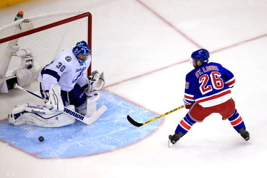 NEW YORK, NY - MAY 18:  Martin St. Louis #26 of the New York Rangers takes a shot on Ben Bishop #30 of the Tampa Bay Lightning in the first period during Game Two of the Eastern Conference Finals during the 2015 NHL Stanley Cup Playoffs at Madison Square Garden on May 18, 2015 in New York City.  (Photo by Alex Trautwig/Getty Images)