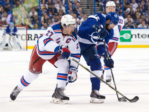 TAMPA, FL - May 20: Alex Killorn #17 of the Tampa Bay Lightning controls the puck against Ryan McDonagh #27 of the New York Rangers during the first period in Game Three of the Eastern Conference Final during the 2015 NHL Stanley Cup Playoffs at the Amalie Arena on May 20, 2015 in Tampa, Florida.  (Photo by Scott Audette/NHLI via Getty Images)