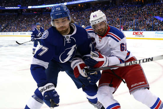 TAMPA, FL - MAY 22:  Rick Nash #61 of the New York Rangers checks Victor Hedman #77 of the Tampa Bay Lightning during the first period in Game Four of the Eastern Conference Finals during the 2015 NHL Stanley Cup Playoffs at Amalie Arena on May 22, 2015 in Tampa, Florida.  (Photo by Bruce Bennett/Getty Images)