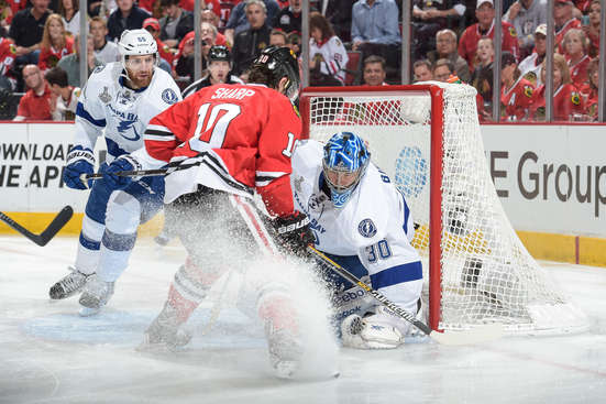 CHICAGO, IL - JUNE 08:  Goalie Ben Bishop #30 of the Tampa Bay Lightning grabs the puck as Patrick Sharp #10 of the Chicago Blackhawks skates in with Braydon Coburn #55 during Game Three of the 2015 NHL Stanley Cup Final at the United Center on June 8, 2015 in Chicago, Illinois.  (Photo by Bill Smith/NHLI via Getty Images)