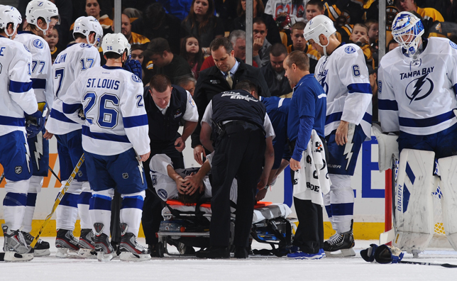 Steven Stamkos breaks his leg against the Boston Bruins